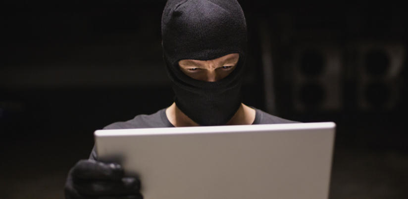Identity theft with gloves and laptop