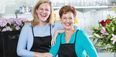 Women working in flower shop