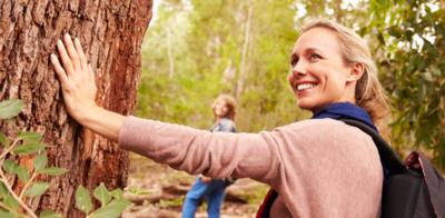 Woman hiking near tree