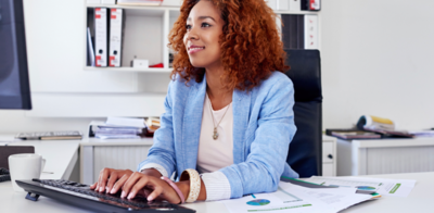 Young black woman on computer